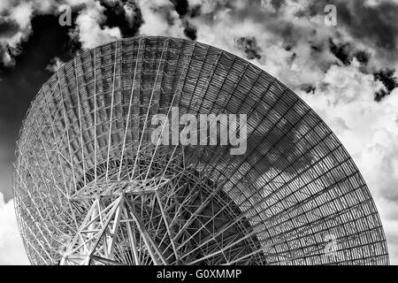 Back of huge radio antenna dish facing cloudy sky in search of space objects as part of CSIRO and NASA communication - Stock Photo