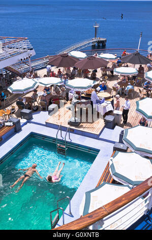 dh CMV Marco Polo cruise ship CRUISING TRAVEL Liner Deck passengers swimming pool buffet relaxing holiday on board - Stock Photo