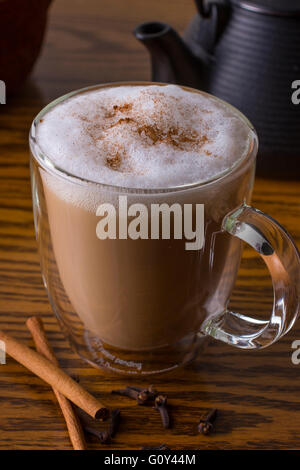 Glass Mug with Spiced Chai and Foam - Stock Photo