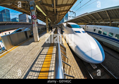N700 class bullet train in Tokyo station - Stock Photo