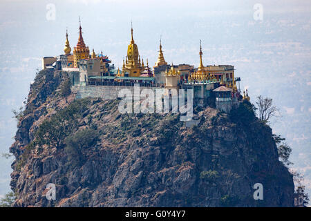 A view from above on the whole of monasteries, stupas and sanctuaries of Taung Kalat Mount Popa (2,427 ft or so). - Stock Photo