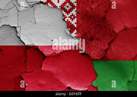 flags of Poland and Belarus painted on cracked wall - Stock Photo