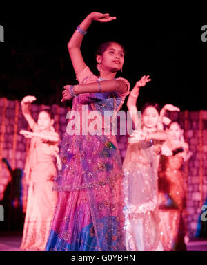 A local dance troupe of orphaned teenagers performs traditional Indian folk dances. Ananda in the Himalayas. India - Stock Photo