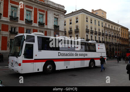 Bus for people to donate blood in Plaza Puerta del Sol, Madrid, Spain - Stock Photo