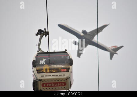 British Airways plane takes off from London City airport. Taken from the Emirates Air Line. - Stock Photo