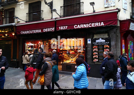 Traditional charcuteria delicatessen food shop in central Madrid, Spain - Stock Photo