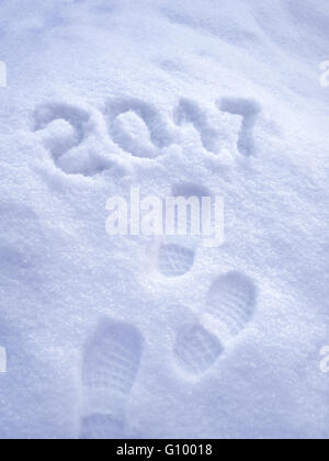 2017 New Year greeting card, Foot step prints in snow, 2017 New Year, foot steps, shoe prints - Stock Photo
