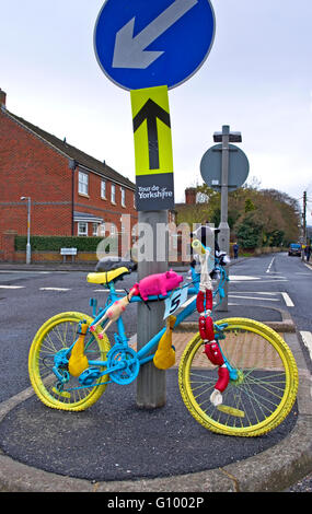 Painted and decorated bike at bollard at road junction in village of Great Ayton on route of Stage 3 of Tour de - Stock Photo