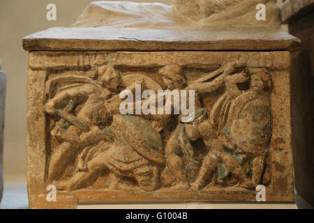 Etruscan cinerary urn. Hero fighting with a plow. Chiusi, Italy. 2nd c. BC. Terracotta. Louvre Museum. Paris. France. - Stock Photo