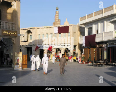 People in shopping street in downtown Doha, Qatar - Stock Photo