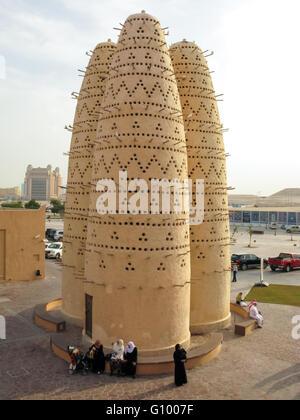 People relaxing near Pigeon Towers in Katara Cultural Village, Doha, Qatar - Stock Photo