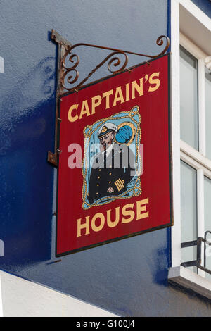 Colorful sign with the illustration of a captain, in Dingle Town, Dingle Peninsula, County Kerry, Republic of Ireland. - Stock Photo