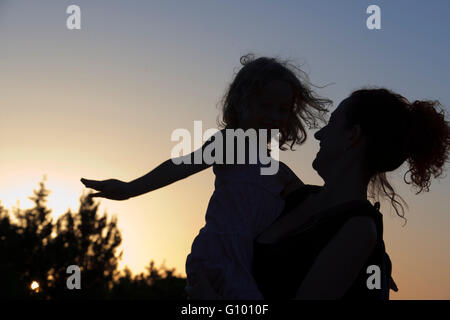 Backlighting. Mother with a child. Sunset. Pudent Lake. Formentera. Balearic Islands, Spain, Europe. - Stock Photo