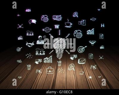 Finance concept: Light Bulb in grunge dark room - Stock Photo