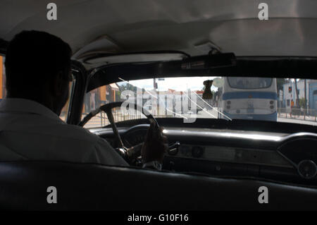 Inside a old taxi 1950s Chevrolet in the street of Santiago de Cuba. - Stock Photo