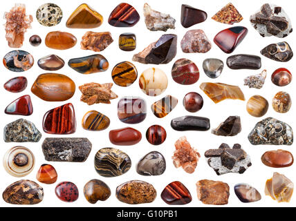 set of brown natural mineral stones and gemstones isolated on white background - Stock Photo
