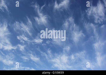 Cloudscape of cirrus uncinus clouds in blue sky - Stock Photo