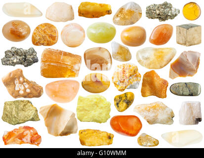 set of yellow and orange natural mineral stones and gemstones isolated on white background - Stock Photo