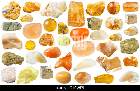 set of yellow natural mineral stones and gemstones isolated on white background - Stock Photo