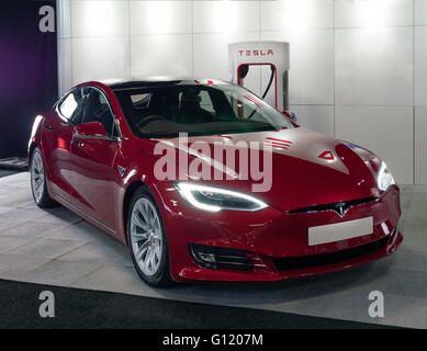 Tesla Electric automobile on charge at Tesla charging point - Stock Photo