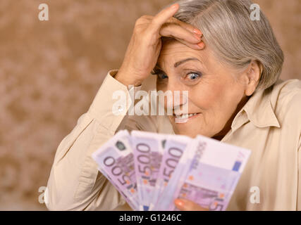 Portrait of aged woman - Stock Photo
