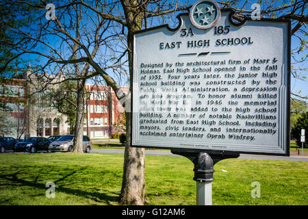 Sign in front of East High School on Gallatin Pike, East Nashville, TN presents historical information of importance, - Stock Photo