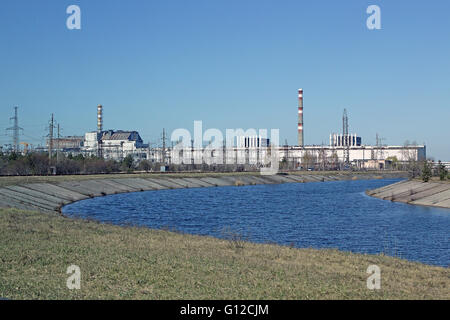 River Pripyat, Chernobyl - Nuclear Power Plant - Reactor 4, 3, 2 & 1 - (Left to Right). - Stock Photo