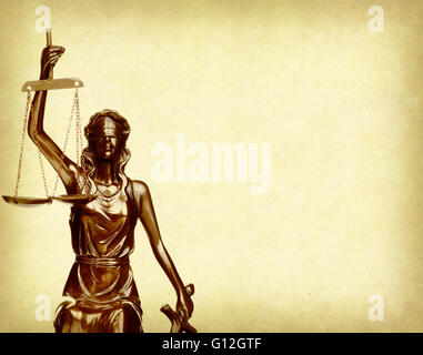 Statue of justice on old paper background, law concept - Stock Photo