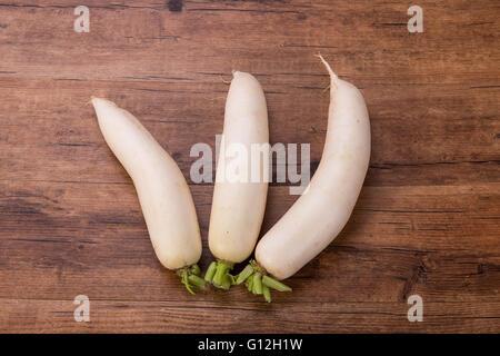 Daikon radish on the wood background - Stock Photo