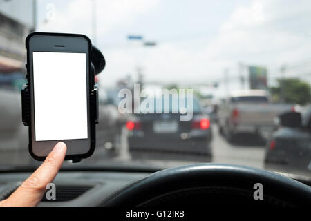 hand and smartphone in a car  use for Navigate - Stock Photo