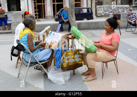 Three women making lace at their stall on the Paseo de Marti (Prado) in Old Havana, Havana, Cuba - Stock Photo