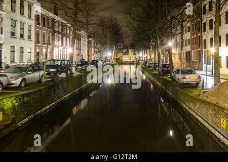 Night shot over a canal in the historical and government main city of The Hague, the Netherlands - Stock Photo