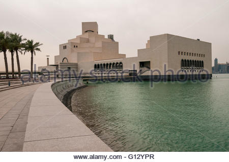 The Museum of Islamic Art seen from the surrounding park area jutting out into the Persian Gulf, Doha, Qatar. - Stock Photo