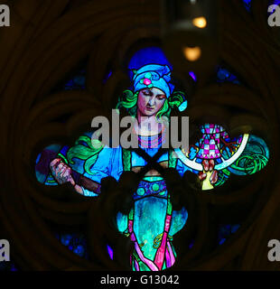 Detail of the Stained Glass window in St. Vitus Cathedral, Prague, designed by Alphonse Mucha. - Stock Photo