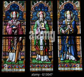 Stained Glass window in St. Vitus Cathedral, Prague, depicting Saints Adalbert of Prague, Cyril and Clement. - Stock Photo