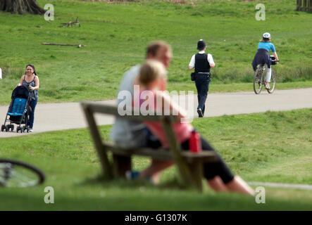A police officer walks in Richmond Park, south west London, Britain May 7, 2016. Copyright photograph John Voos - Stock Photo