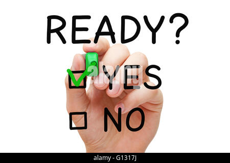 Hand putting check mark with green marker on Yes Ready. Readiness concept. - Stock Photo