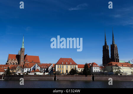 Ostrow Tumski at Odra river with the Cathedral and the Collegiate Church of the Holy Cross and St. Bartholomew in - Stock Photo