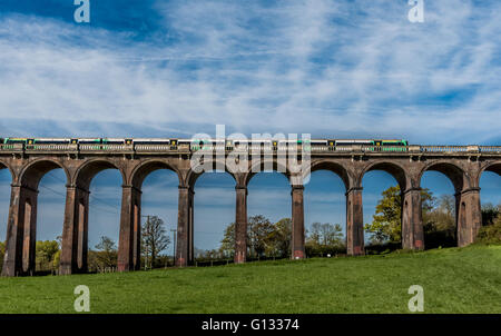 Southern Rail train passing over Ouse Valley Viaduct in Sussex - Stock Photo