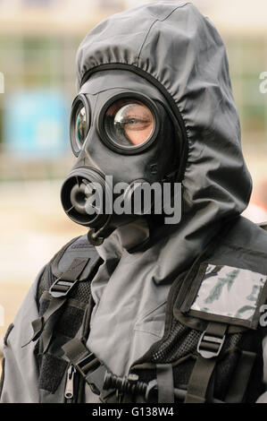 Belfast, Northern Ireland 26 Oct 2011 -  PSNI officer wears wearing Quick Don Protective Suits during the launch - Stock Photo