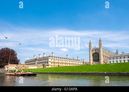 A group of punters punt punting along the cam river on a sunny day in may with a backdrop of the Kings college chapel - Stock Photo