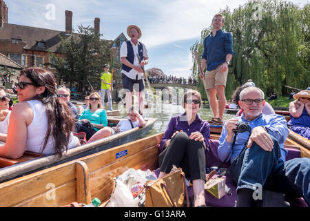 A crowd of punting boats collide crash hit along the Cam River punt tour on a sunny day in May. - Stock Photo