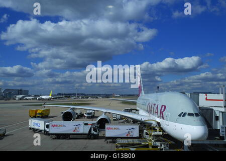 Qatar Airways Airbus A380-800 being loaded on the stand at London Heathrow Airport - Stock Photo