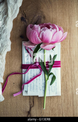 Old letters tied with velvet ribbon - Stock Photo