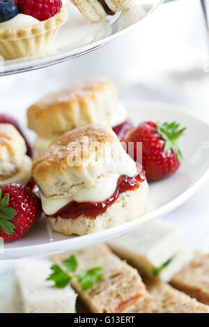 Afternoon tea served on a tiered cake stand - Stock Photo