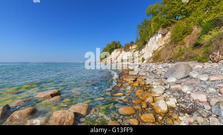 Beach and chalk cliffs on the Rugen Island, Jasmund National Park, Mecklenburg Vorpommern region in Germany. - Stock Photo