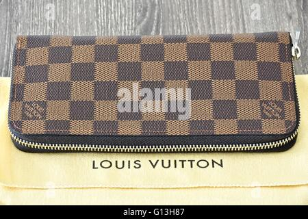 A Louis Vuiton zippy wallet - Stock Photo