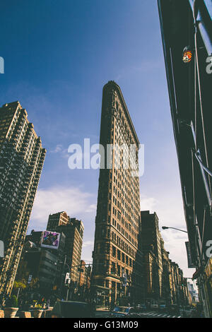 NEW YORK, USA - MAY 4, 2016: Flat Iron building facade in New York City. Completed in 1902, it is considered to - Stock Photo