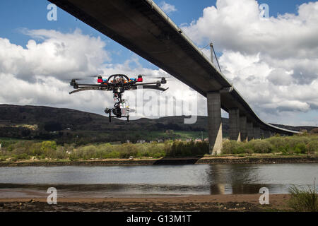 Drone flying next to Erskine Bridge - Stock Photo