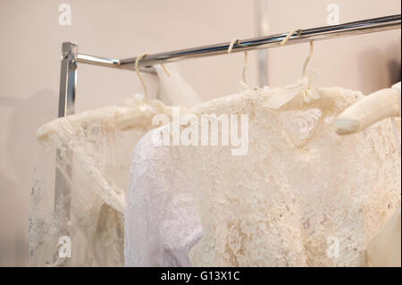 Beautiful white cream wedding dresses made of silk chiffon - Stock Photo